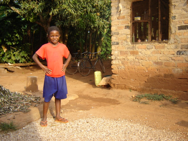 Annet and her brother Tom live near the church.  Their family is very poor, and as a result, they have missed school this whole year.  Tom approached John and requested help.  They've also received food from the Food Program.