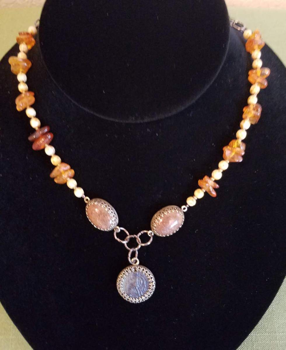 Roman coin with amber and Chrysanthemum cabochons necklace
