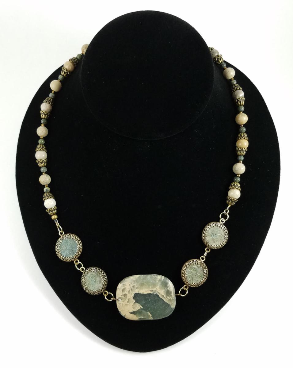 Jasper necklace with four Roman coins