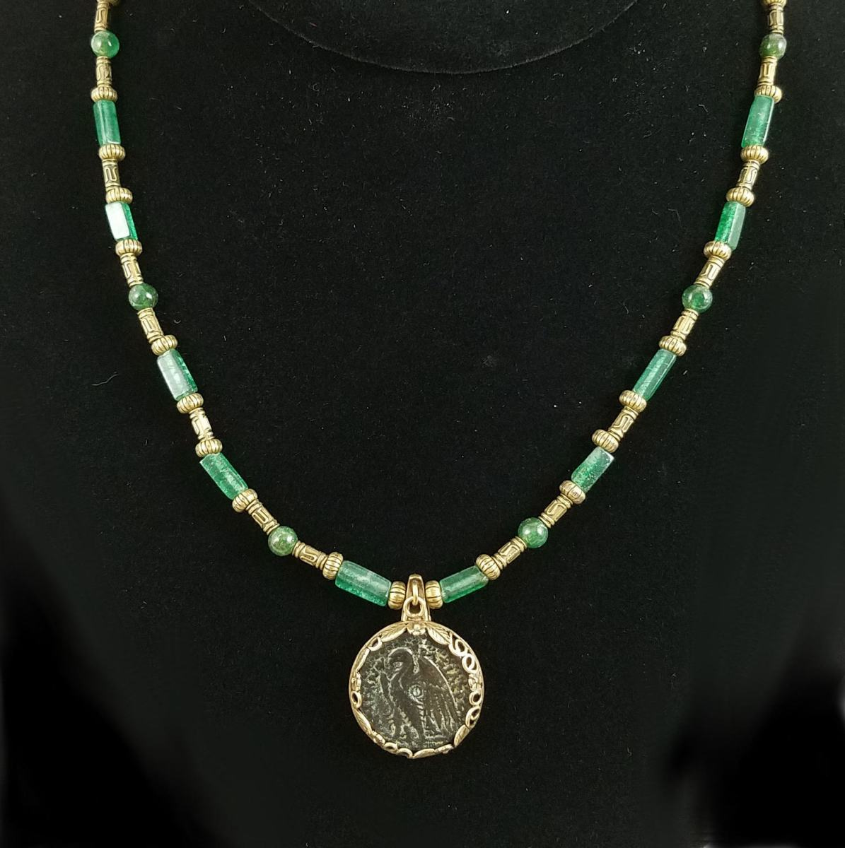Coin of Ptlemy II on strand of antique brass and green aventurine beads