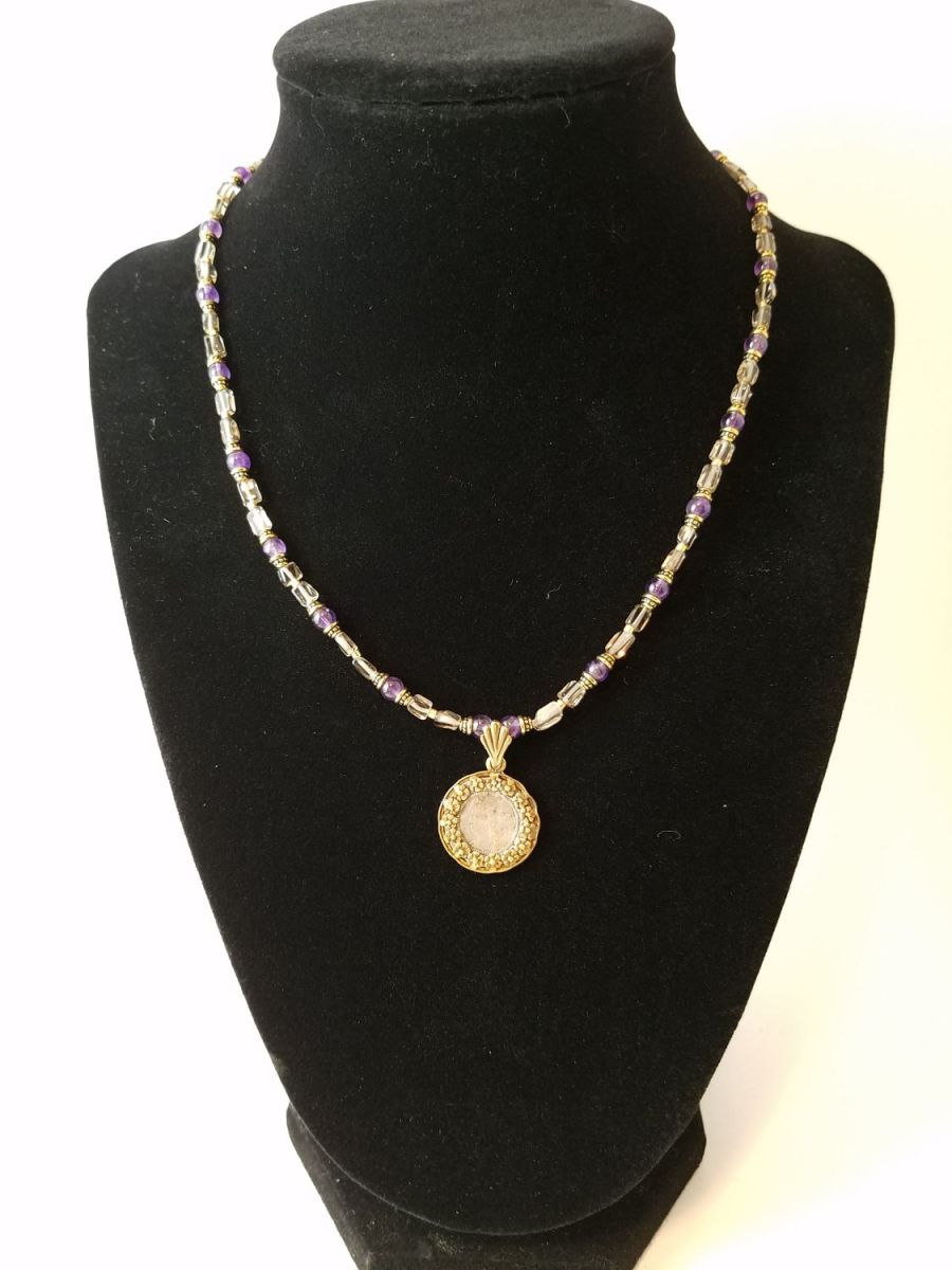 Necklace with coin of Elizabeth I surrounded by flowers with amethyst and smoky quartz beads
