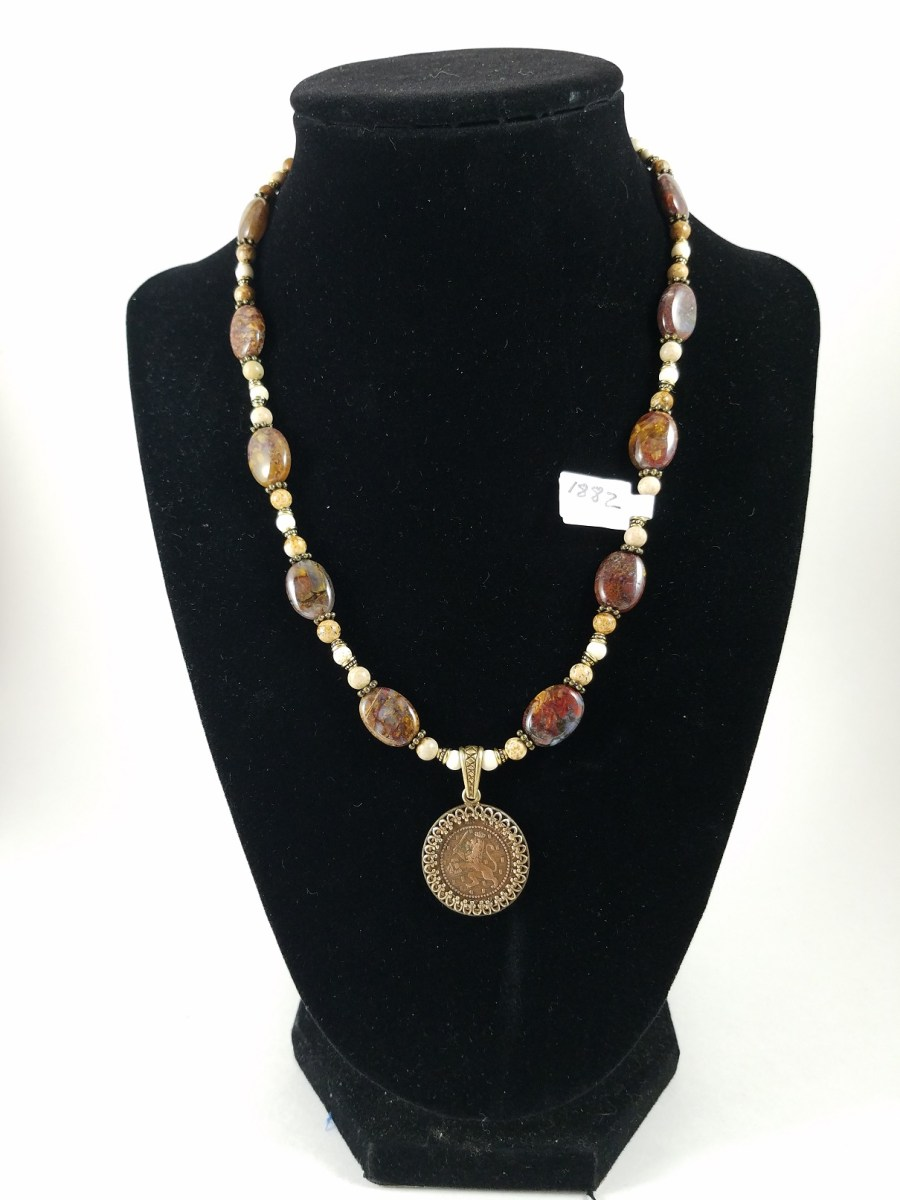 Necklace with Dutch coin and brown and white beads