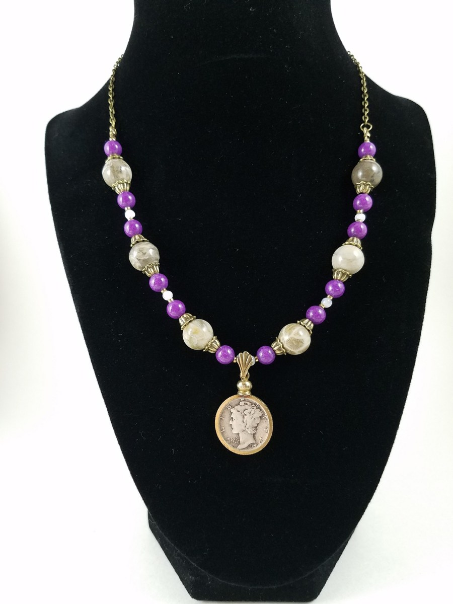 Necklace with Mercury dime and white and purple beads