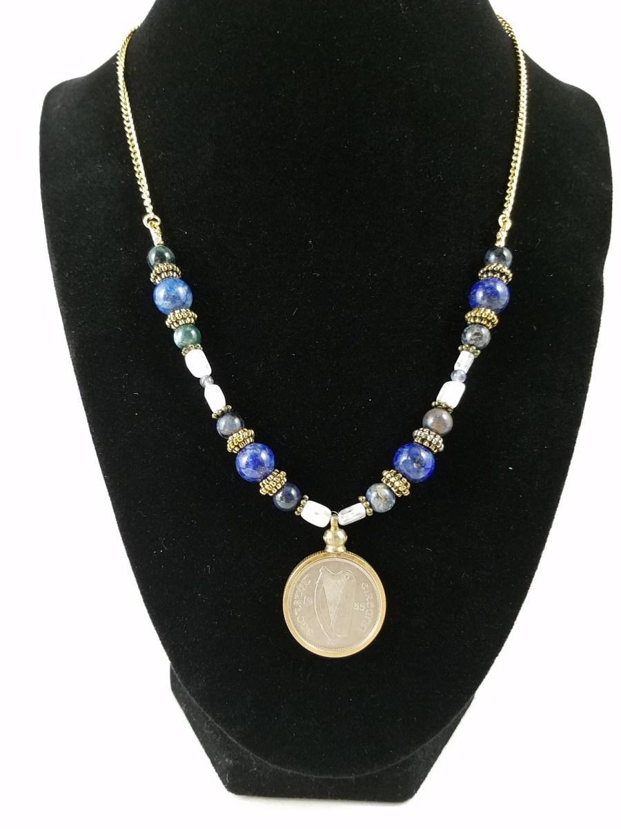Necklace with Irish six pence and blue and white beads