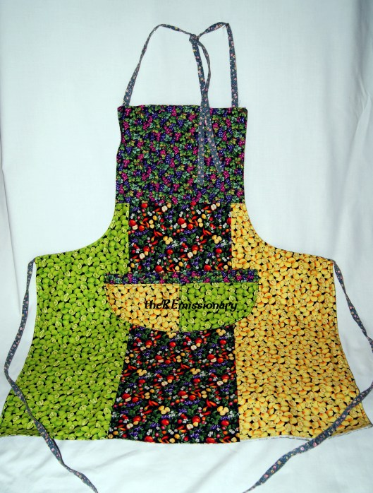 $10.00 - reversible apron made from strips of fabric from other projects