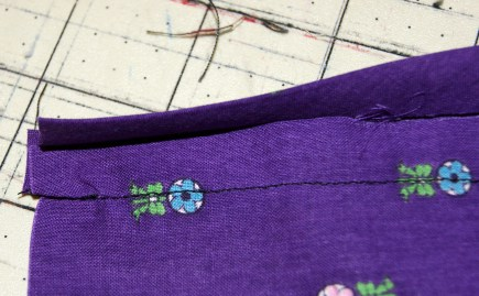 sewn to wrong side - pull to front of panel and pin down