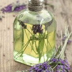 bottle of lavender oil with fresh flowers