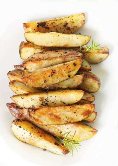 Banish boring potato sides and give your next party a punch by making one of these flavorful potato wedge recipes. 10 Flavorful Potato Wedge Recipes ~ Tipsaholic.com #sides #potato #fries