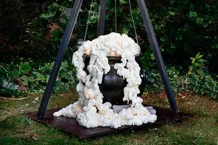 Make an outdoor decorative witch cauldron This Old House - 25 Clever Outdoor Halloween Decorations - Remodelaholic.com. #Halloween, #decorations, #halloweendecor, #Halloweendiy, #spooky