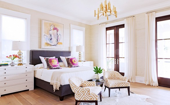 Brass in the bedroom looks modern paired with light colors and bright accents.  via Domaine