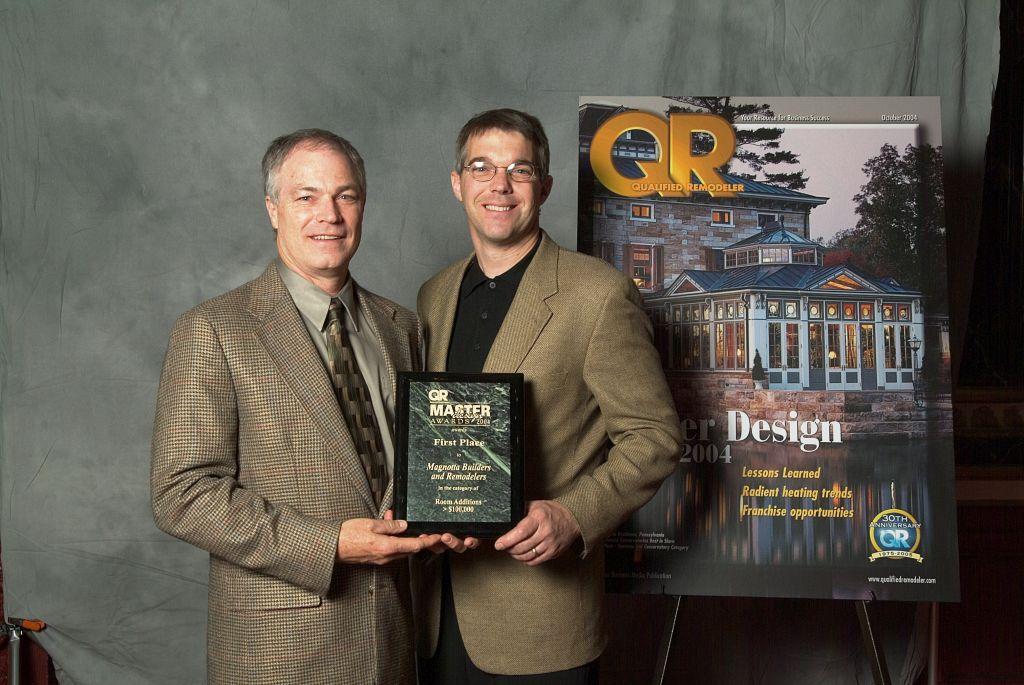 Jim Magnotta and David Frost recieve the QR Master Design Award