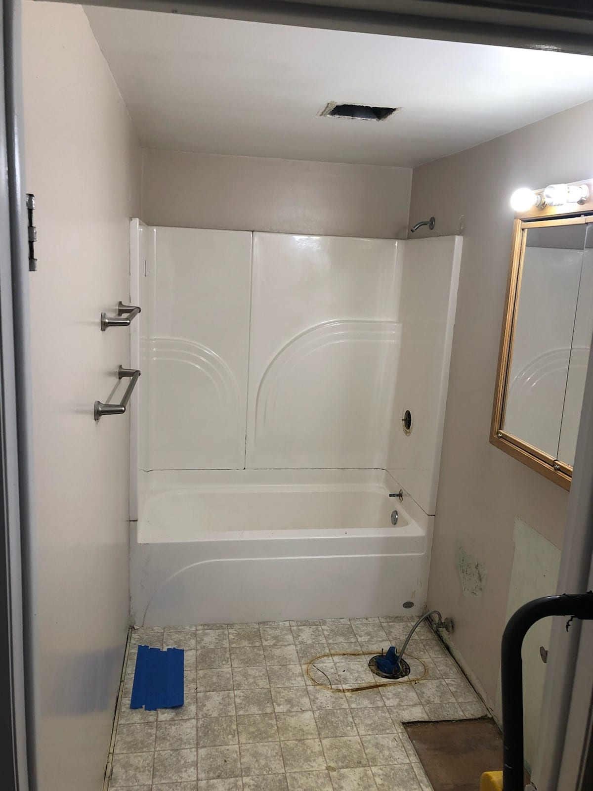 replace a fiberglass tub with tile