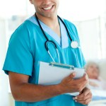 Attractive male doctor holding a medical clipboard