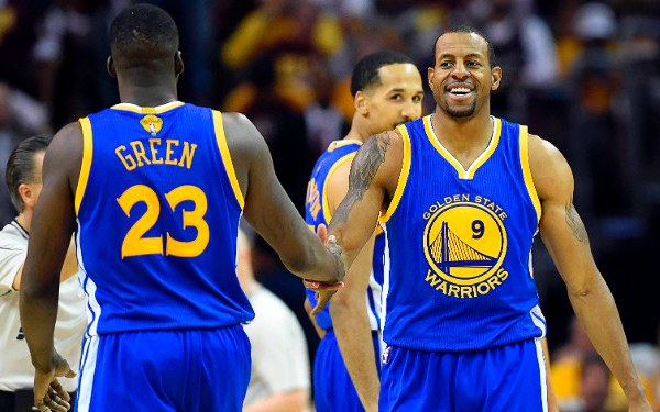 Jun 11, 2015; Cleveland, OH, USA; Golden State Warriors guard Andre Iguodala (9) celebrates with forward Draymond Green (23) during the third quarter against the Cleveland Cavaliers in game four of the NBA Finals at Quicken Loans Arena. Mandatory Credit: Bob Donnan-USA TODAY Sports