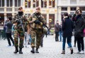 Belgian Army soldiers patrol in the picturesque Grand Place in the center of Brussels on Friday, Nov. 20, 2015. Salah Abdeslam, a French national who lived in Molenbeek, Belgium, is currently the subject of an international manhunt after the Paris attacks. Security has been stepped up in parts of Belgium as a precaution. (AP Photo/Geert Vanden Wijngaert)