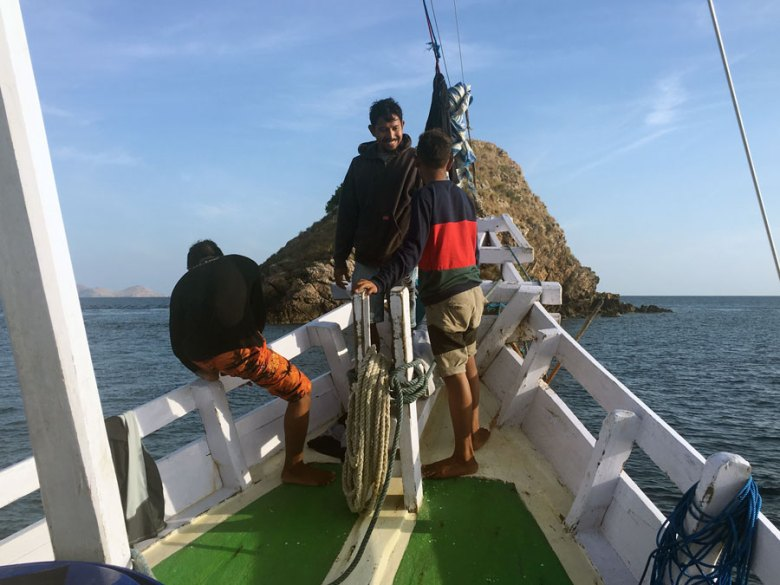 Indonesian boat crew mates and guide on a liveaboard