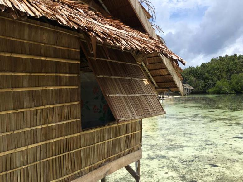 Beser bay overwater thatched Palm bungalow Raja Ampat