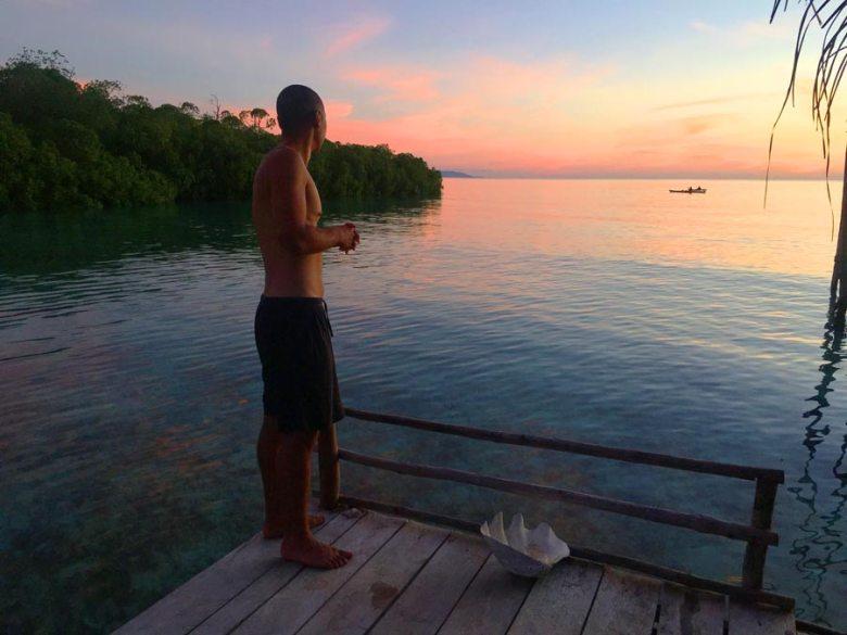 Raja Ampat sunset view Dampier Strait overwater bungalow deck beser bay homestay