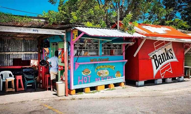 Street side roti shack restaurant in bright Caribbean colours