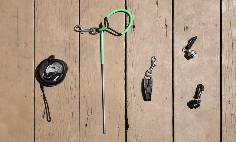 Scuba accessories laid out on decking