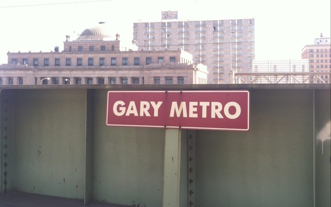 gary metro sign at the train station with downtown gary in the background