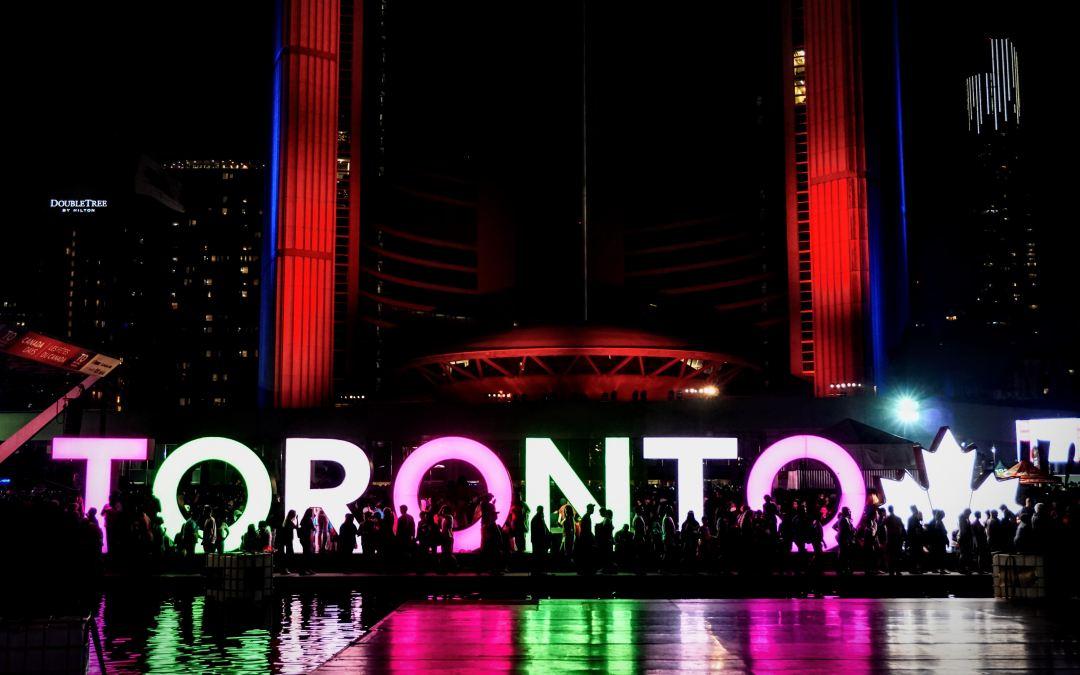 Toronto sign in front of Toronto's city hall at night. Photo by Maarten van den Heuvel on Unsplash