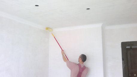 whitewashing the ceiling in the hallway