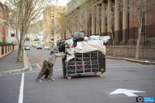 A hawker pushes his wares to a night shelter in Cape Town, South Africa.