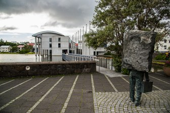 """Memorial To The Unknown Bureaucrat"" , sculpture by Matthias Hauser on Reykjavic Tjörnin (Pond). Nikon D810, 28.0mm (24-120.0mm ƒ/4.0) 1/320 sec ƒ/8 ISO 400"