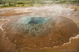 A hot water spring in Strokkur. Nikon D810, 24 mm (24-120.0 mm ƒ/4) 1/100 sec ƒ/3.5 ISO 64