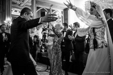 "General Elchin Guliyev (Azerbaijan , left, dancing), Badrutt's Palace cocktail reception, Snow Polo World Cup, St. Moritz, January 2018. Nikon D810, 35 mm (35 mm ƒ/2) 1/80"" ƒ/2 ISO 2500"