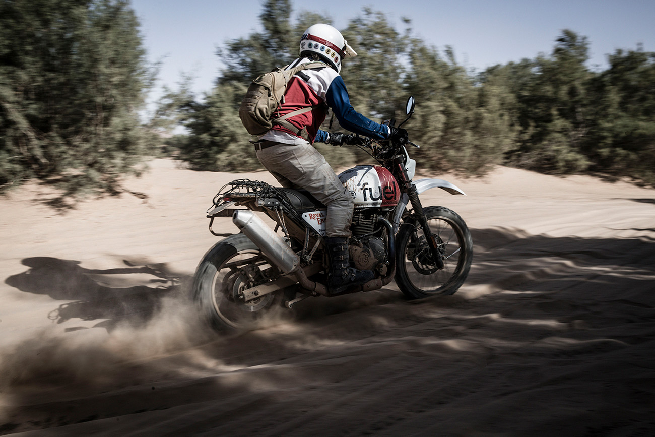 Custom Scrambler Riding across sand