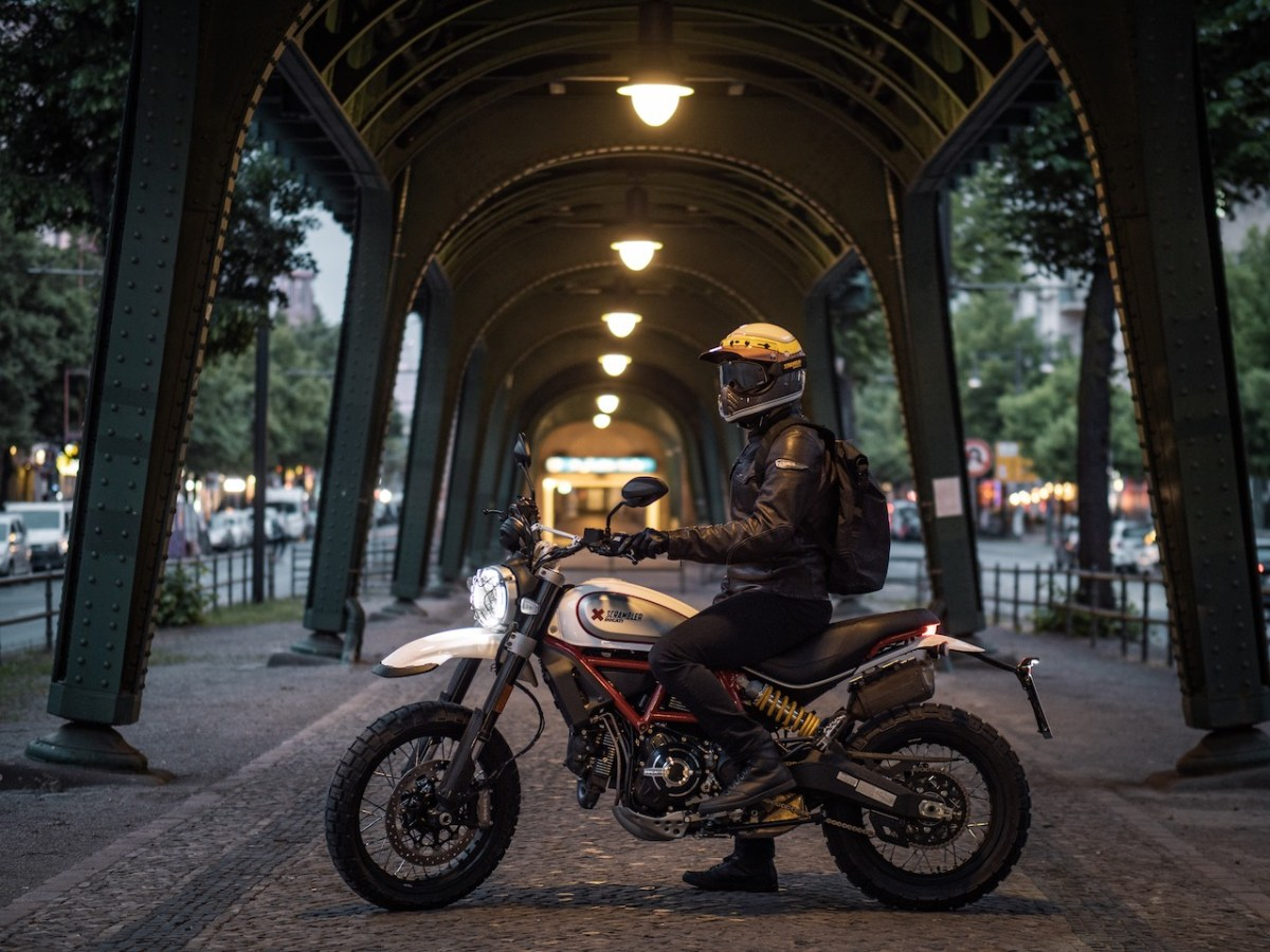 Ducati Desert Sled with rider under a bridge