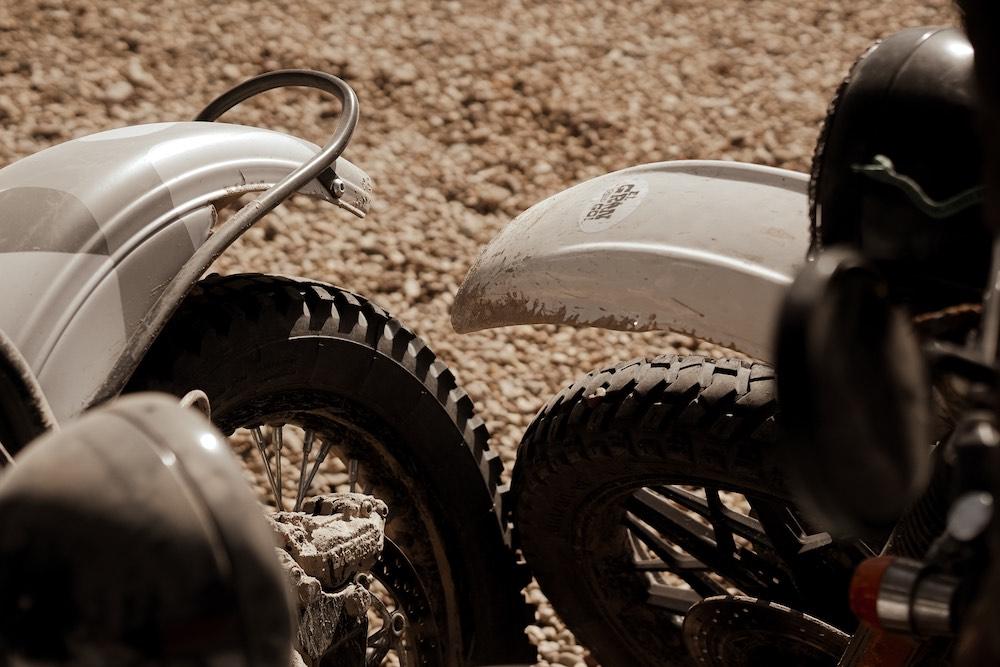 El Gringo Tour - Front wheels of two Scrambler motorcycles touching - Gus Galvani