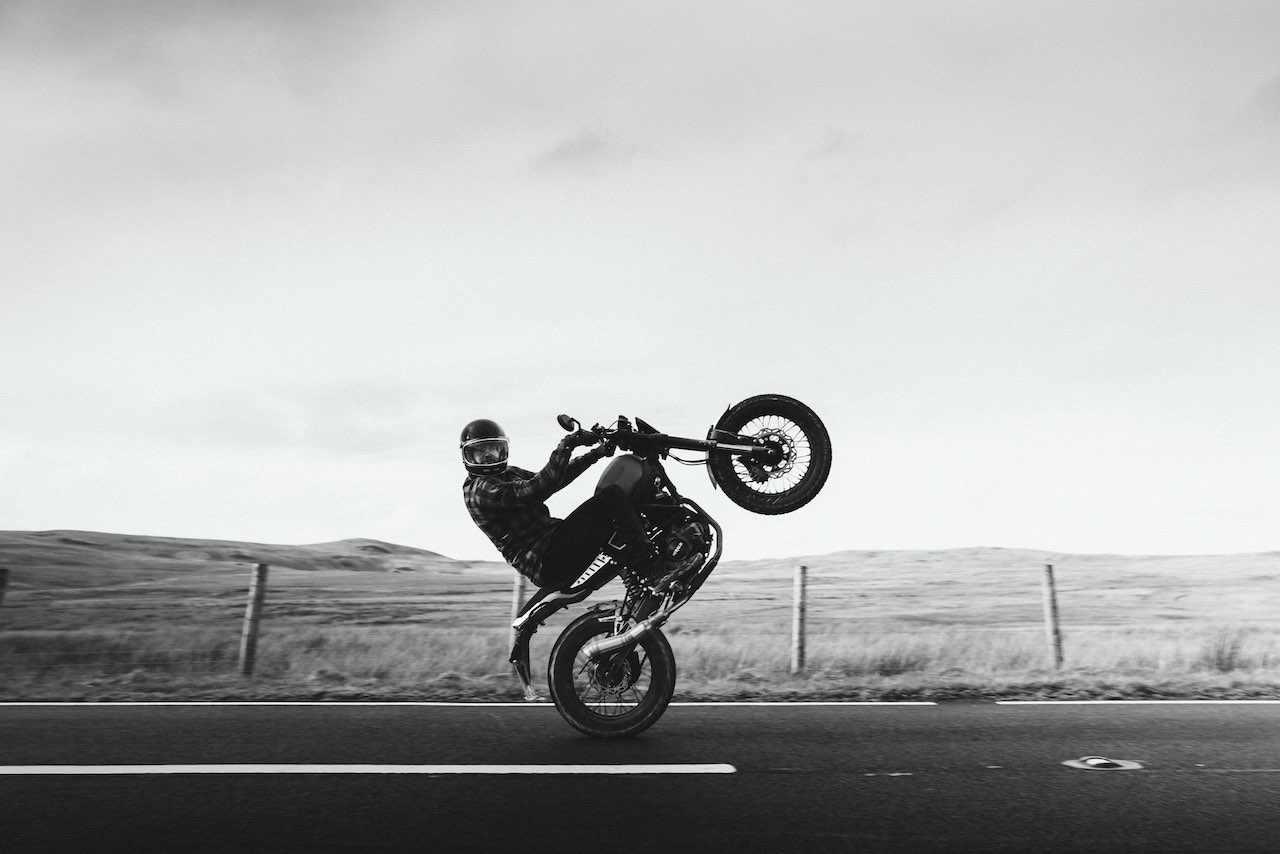 Rider performing a wheelie