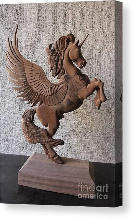the unicorn sculpture wood