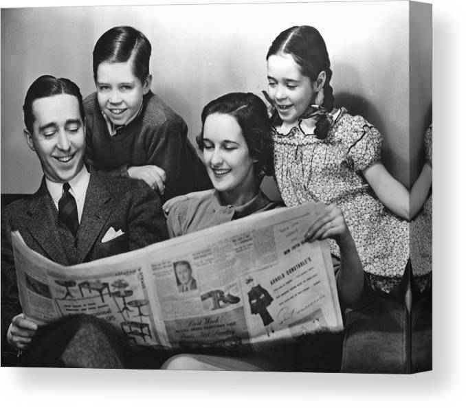 family reading newspaper canvas