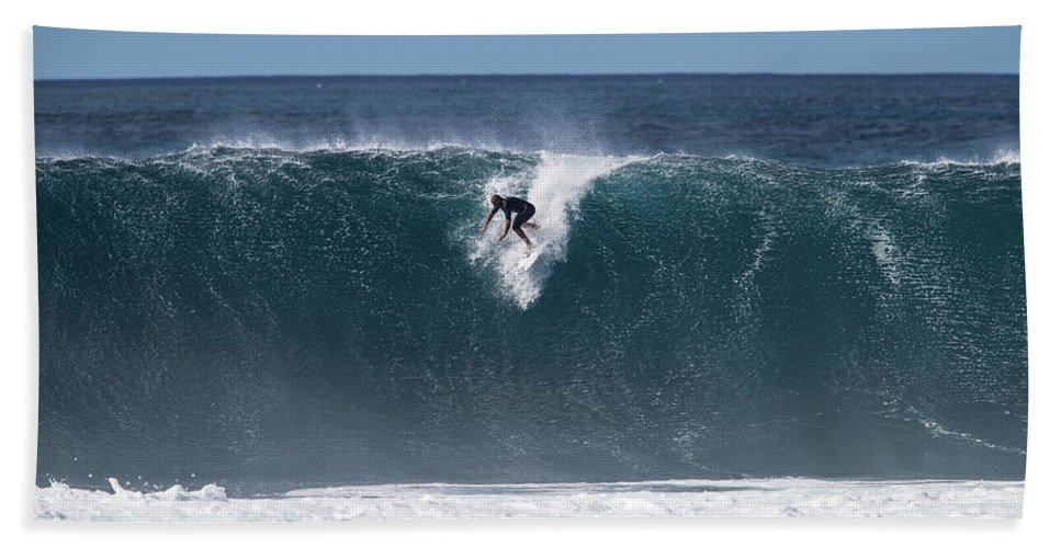 man surfing down a