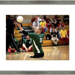 Wheelchair Volleyball The Chair Is Against Wall T Shirt Sitting Framed Print By Us Air Force Mark Fayloga 2012 Featuring Photograph