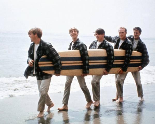 beach boys on the beach with a surfboard poster