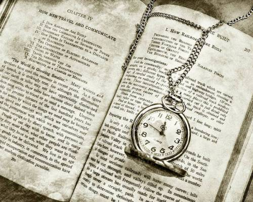 Time to Read is a sepia image, featuring a pocket watch and book by Sharon Popek