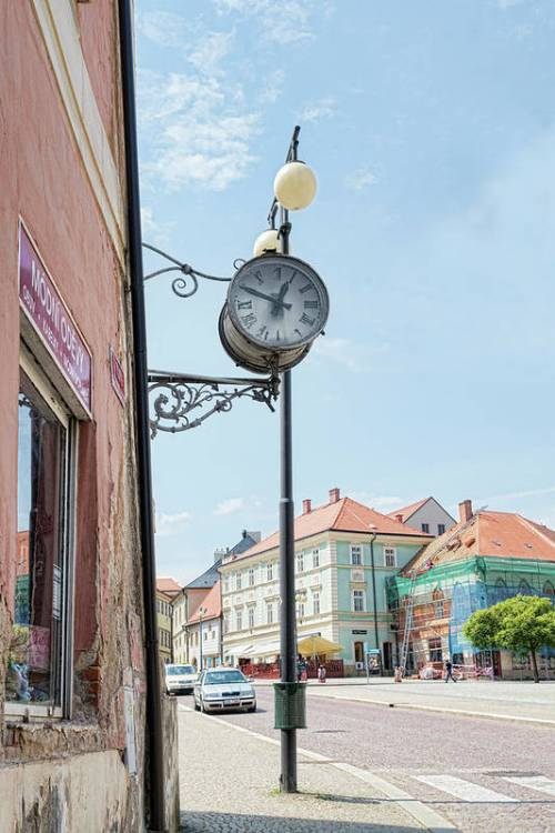 A shop clock in Kutna Hora, Czechia.