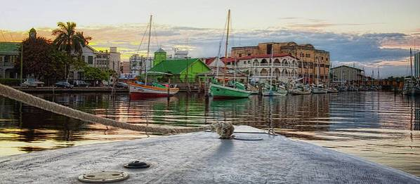 Belize City Harbor at dusk by Tatiana Travelways