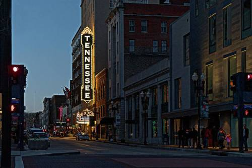 Downtown Knoxville, TN, featuring the Tennessee Theatre marquee after dark.