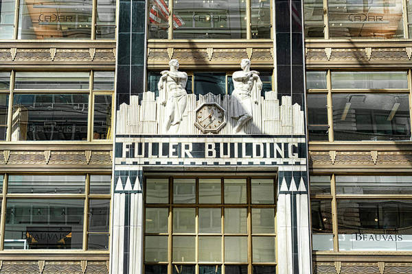 Clock at the entry to the Fuller Building in New York City.