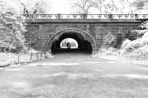 Central Park Trefoil Arch with people walking through.