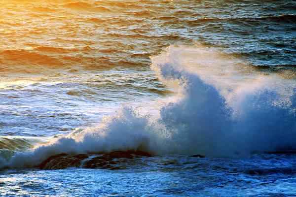 Energizing ocean waves in the golden light