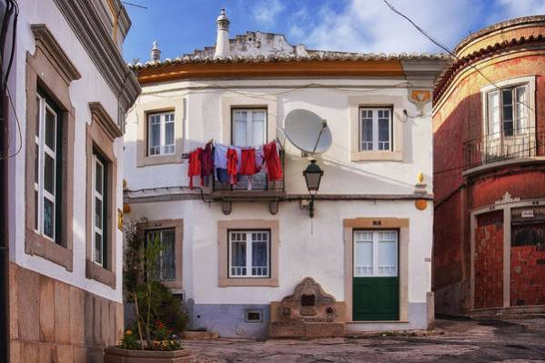 Laundry Art Print featuring the photograph Laundry and architecture in Estoi, Portugal by Tatiana Travelways
