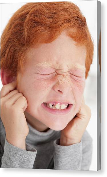 Boy Putting Fingers In Ears With Eyes Closed Photograph by ...