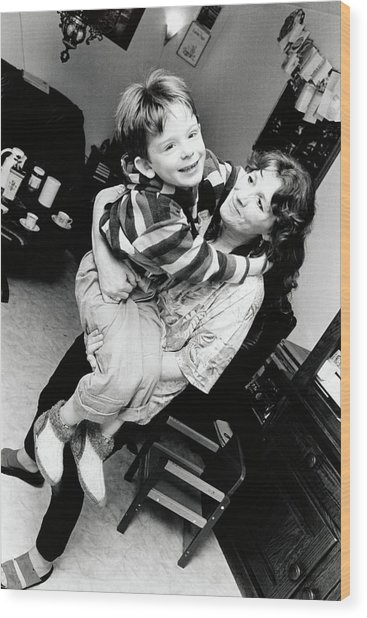 rocking chair for autistic child world market beach chairs with his mother photograph by henny allis science wood print photo library